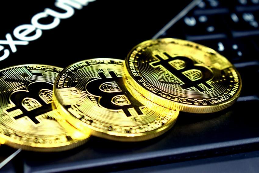 Bitcoins symbolisch als Münzen dargestellt