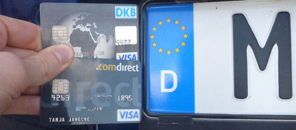 DKB and Comdirect VISA front of a German car number plates