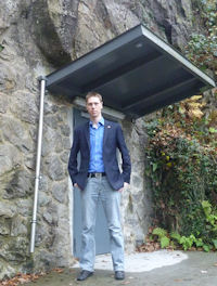 The author in front of the entrance to a precious metal vault in a Swiss mountain massif.